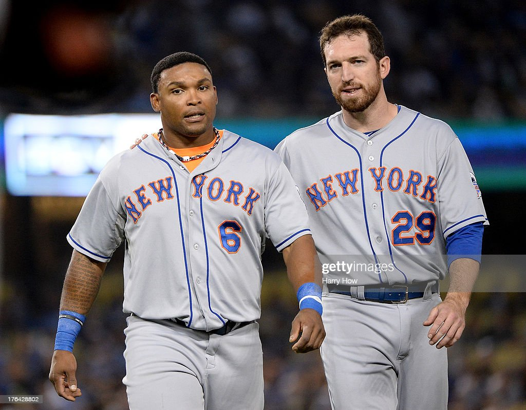Marlon Byrd #6 and Ike Davis #29 of the New York Mets talk as they leave the field at the end of the third inning against the Los Angeles Dodgers at Dodger Stadium on August 12, 2013 in Los Angeles, California.