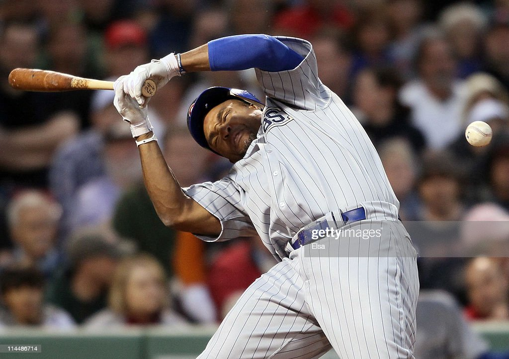 <a gi-track='captionPersonalityLinkClicked' href=/galleries/search?phrase=Marlon+Byrd&family=editorial&specificpeople=217377 ng-click='$event.stopPropagation()'>Marlon Byrd</a> #24 of the Chicago Cubs is hits a in the head by a pitch in the second inning against the Boston Red Sox on May 21, 2011 at Fenway Park in Boston, Massachusetts. Tonight the Chicago Cubs and the Boston Red Sox are wearing replica uniforms from 1918. Before this series, the two teams haven't played at Fenway Park since the 1918 World Series.