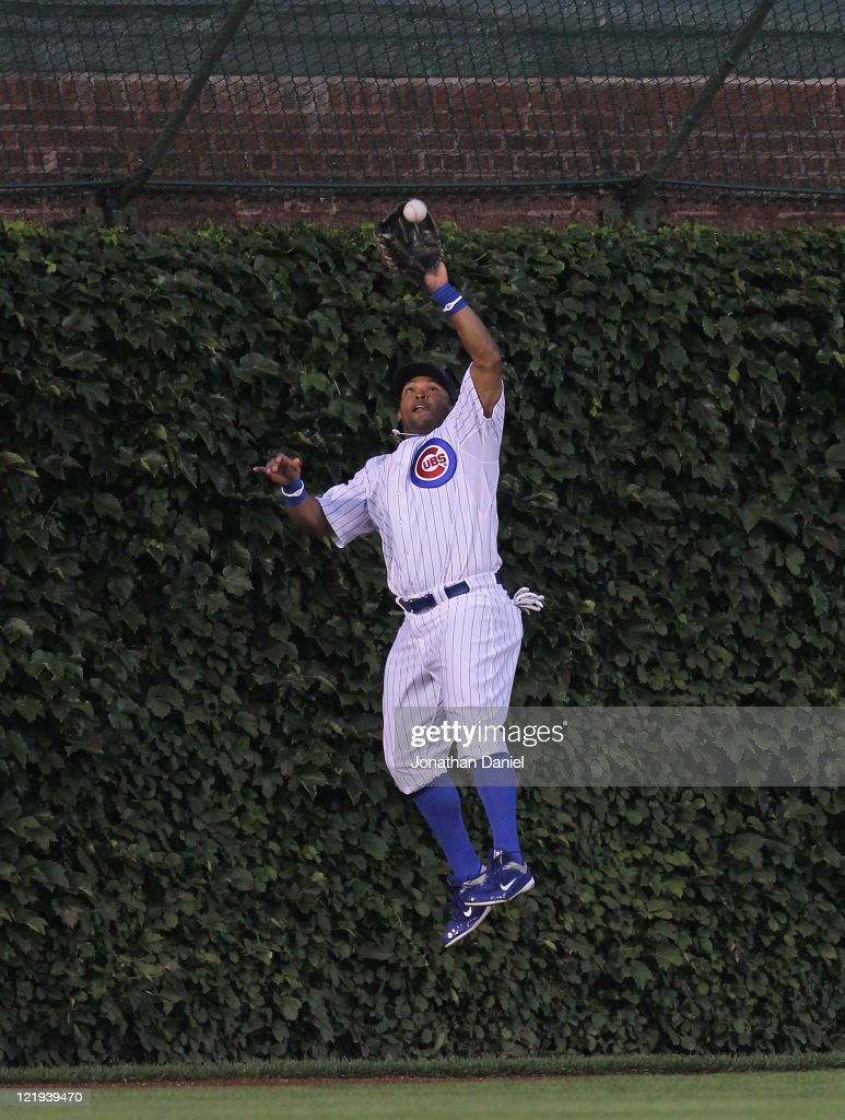<a gi-track='captionPersonalityLinkClicked' href=/galleries/search?phrase=Marlon+Byrd&family=editorial&specificpeople=217377 ng-click='$event.stopPropagation()'>Marlon Byrd</a> #24 of the Chicago Cubs leaps to make a catch at the wall of a fly ball hit by Dan Uggla of the Atlanta Braves at Wrigley Field on August 23, 2011 in Chicago, Illinois.