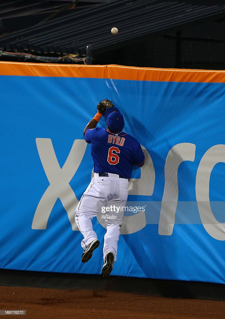Marlon Byrd #6 of the New York Mets cannot catch a home run by Greg Dobbs #29 of the Miami Marlins in the second inning during their game on April 5, 2013 at Citi Field in the Flushing neighborhood of the Queens borough of New York City.