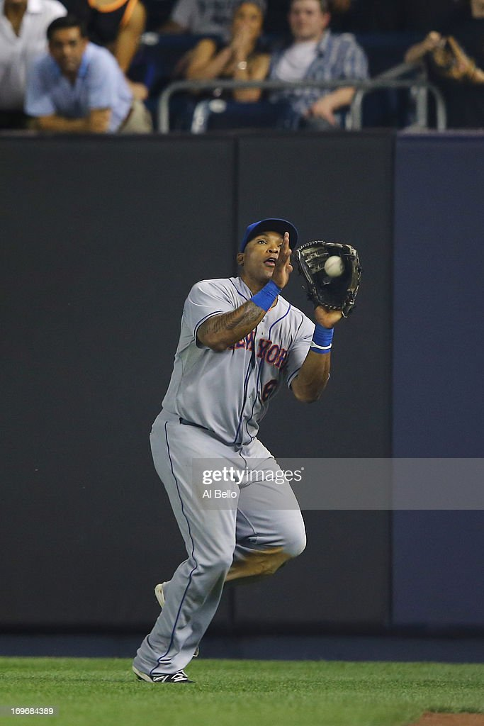 <a gi-track='captionPersonalityLinkClicked' href=/galleries/search?phrase=Marlon+Byrd&family=editorial&specificpeople=217377 ng-click='$event.stopPropagation()'>Marlon Byrd</a> #6 of the New York Mets catches a ball hit by Vernon Wells #12 of the New York Yankees in the ninth inning during their game on May 30, 2013 at Yankee Stadium in the Bronx borough of New York City