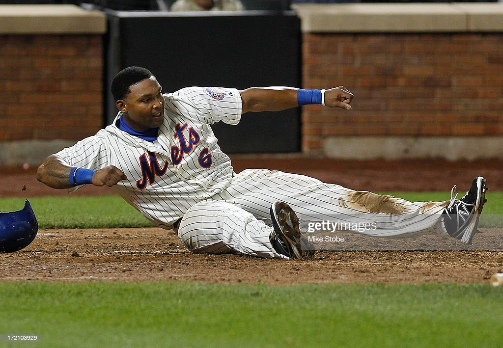 Marlon Byrd #6 of the New York Mets celebrates after scoring on Josh Satin #13 RBI single in the ninth inning against the Arizona Diamondbacks at Citi Field on July 1, 2013 at Citi Field in the Flushing neighborhood of the Queens borough of New York City.