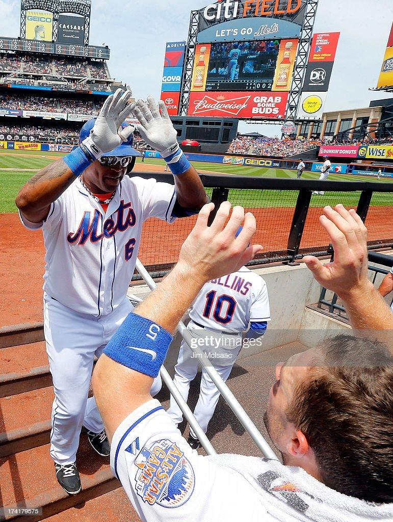 <a gi-track='captionPersonalityLinkClicked' href=/galleries/search?phrase=Marlon+Byrd&family=editorial&specificpeople=217377 ng-click='$event.stopPropagation()'>Marlon Byrd</a> #6 of the New York Mets celebrates his first inning home run against the Philadelphia Phillies with teammate <a gi-track='captionPersonalityLinkClicked' href=/galleries/search?phrase=David+Wright+-+Baseball+Player&family=editorial&specificpeople=209172 ng-click='$event.stopPropagation()'>David Wright</a> #5 at Citi Field on July 21, 2013 in the Flushing neighborhood of the Queens borough of New York City.