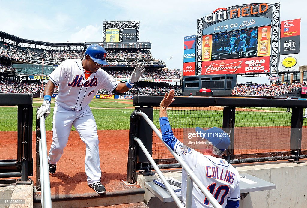 Marlon Byrd #6 of the New York Mets celebrates his first inning home run against the Philadelphia Phillies with manager Terry Collins #10 of the New York Mets at Citi Field on July 21, 2013 in the Flushing neighborhood of the Queens borough of New York City.