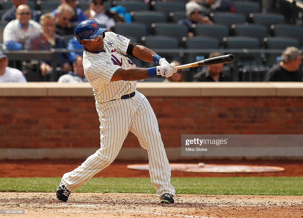 <a gi-track='captionPersonalityLinkClicked' href=/galleries/search?phrase=Marlon+Byrd&family=editorial&specificpeople=217377 ng-click='$event.stopPropagation()'>Marlon Byrd</a> #6 of the New York Mets hits a RBI single in the fourth inning against the San Diego Padres on opening day at Citi Field on April 1, 2013 in the Flushing neighborhood of the Queens borough of New York City.