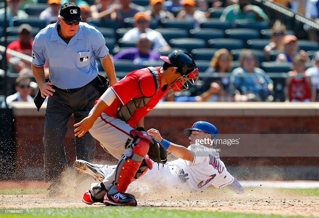 <a gi-track='captionPersonalityLinkClicked' href=/galleries/search?phrase=Marlon+Byrd&family=editorial&specificpeople=217377 ng-click='$event.stopPropagation()'>Marlon Byrd</a> #6 of the New York Mets is safe ahead of the tag from <a gi-track='captionPersonalityLinkClicked' href=/galleries/search?phrase=Kurt+Suzuki&family=editorial&specificpeople=682702 ng-click='$event.stopPropagation()'>Kurt Suzuki</a> #24 of the Washington Nationals as he scores on a sixth inning sacrfice fly by teammate Eric Young Jr (not pictured) as home plate umpire Dana DeMuth looks to make the call at Citi Field on June 29, 2013 in the Flushing neighborhood of the Queens borough of New York City. The Mets defeated the Nationals 5-1.