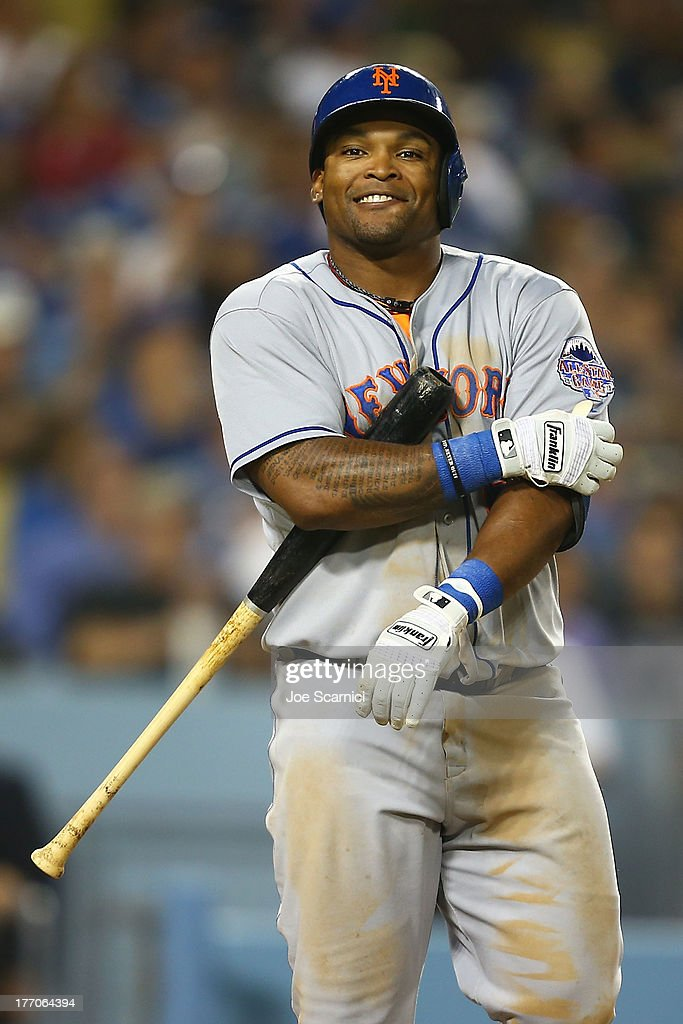 Marlon Byrd #6 of the New York Mets reacts to a strikeout to end the seventh inning against the Los Angeles Dodgers at Dodger Stadium on August 14, 2013 in Los Angeles, California.