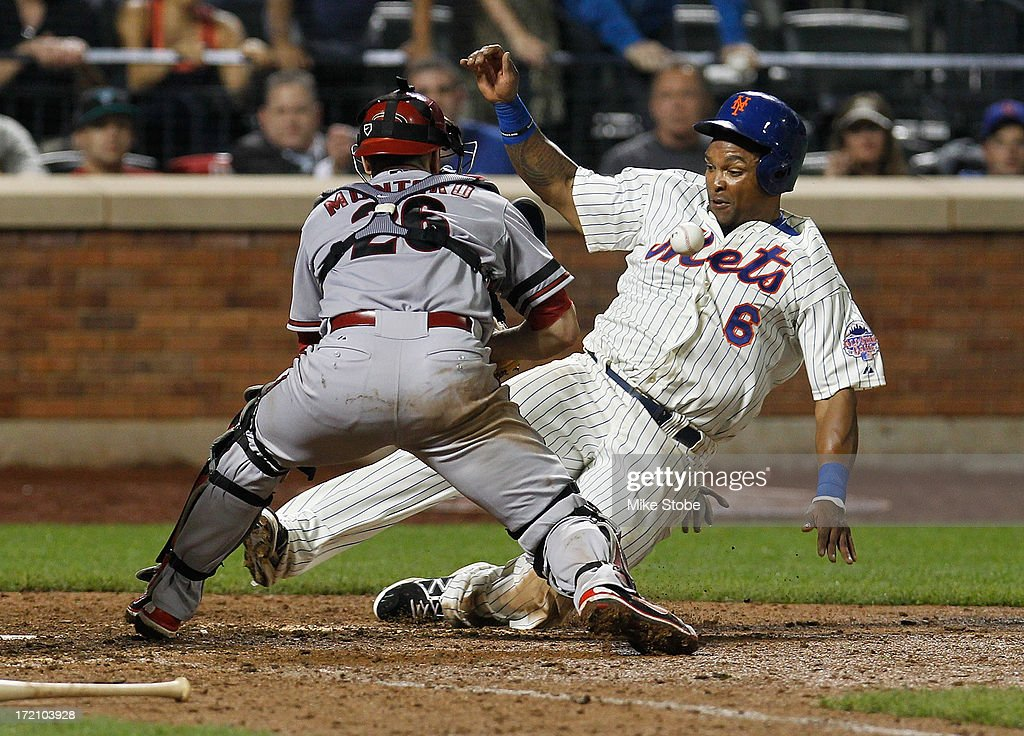 <a gi-track='captionPersonalityLinkClicked' href=/galleries/search?phrase=Marlon+Byrd&family=editorial&specificpeople=217377 ng-click='$event.stopPropagation()'>Marlon Byrd</a> #6 of the New York Mets slides in ahead of the ball scoring on Josh Satin #13 RBI single in the ninth inning against the Arizona Diamondbacks at Citi Field on July 1, 2013 at Citi Field in the Flushing neighborhood of the Queens borough of New York City.