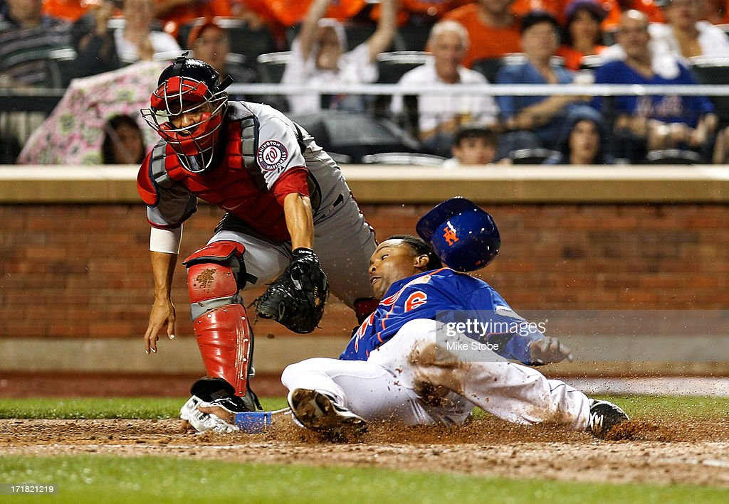 Marlon Byrd #6 of the New York Mets slides in ahead of the tag of Kurt Suzuki #24 of the Washington Nationals on Josh Satin #13 RBI single in the sixth inning at Citi Field on June 28, 2013 at Citi Field in the Flushing neighborhood of the Queens borough of New York City.