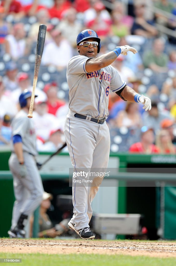 <a gi-track='captionPersonalityLinkClicked' href=/galleries/search?phrase=Marlon+Byrd&family=editorial&specificpeople=217377 ng-click='$event.stopPropagation()'>Marlon Byrd</a> #6 of the New York Mets tosses his bat after flying out in the seventh inning against the Washington Nationals at Nationals Park on July 26, 2013 in Washington, DC. New York won the game 11-0.