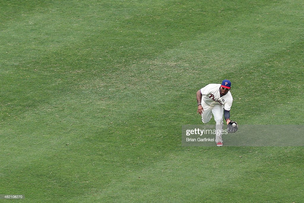 <a gi-track='captionPersonalityLinkClicked' href=/galleries/search?phrase=Marlon+Byrd&family=editorial&specificpeople=217377 ng-click='$event.stopPropagation()'>Marlon Byrd</a> #3 of the Philadelphia Phillies catches a Ryan Zimmerman #11 of the Washington Nationals long fly in the sixth inning of the game at Citizens Bank Park on July 13, 2014 in Philadelphia, Pennsylvania. The Nationals won 10-3.