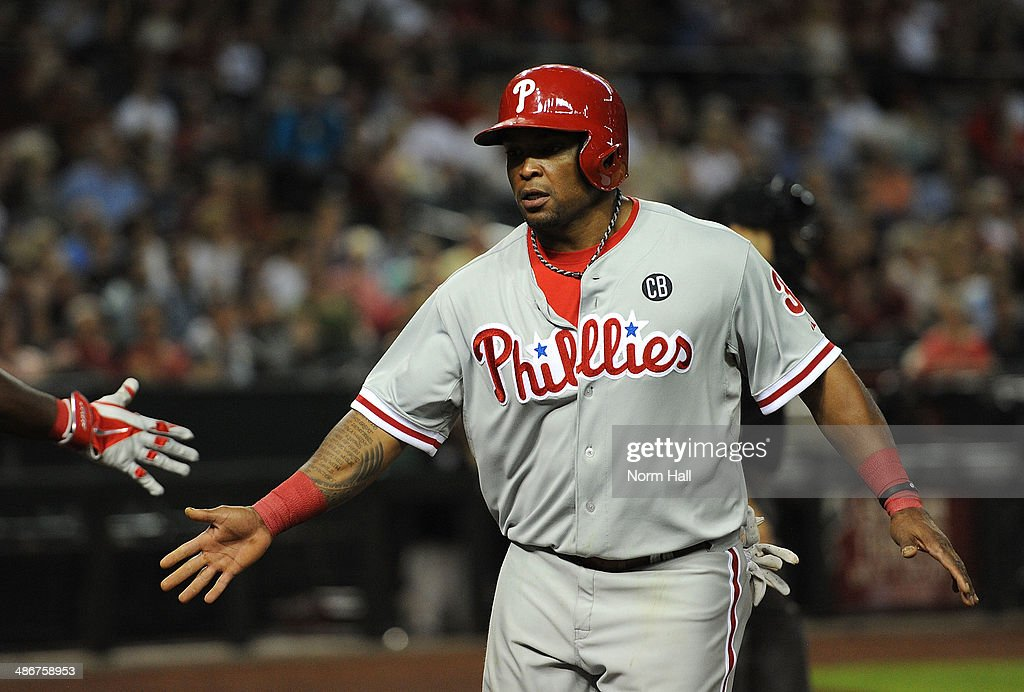 <a gi-track='captionPersonalityLinkClicked' href=/galleries/search?phrase=Marlon+Byrd&family=editorial&specificpeople=217377 ng-click='$event.stopPropagation()'>Marlon Byrd</a> #3 of the Philadelphia Phillies celebrates a run against the Arizona Diamondbacks in the seventh inning at Chase Field on April 25, 2014 in Phoenix, Arizona.