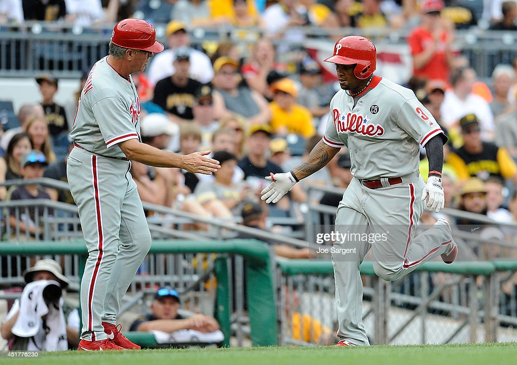 <a gi-track='captionPersonalityLinkClicked' href=/galleries/search?phrase=Marlon+Byrd&family=editorial&specificpeople=217377 ng-click='$event.stopPropagation()'>Marlon Byrd</a> #3 of the Philadelphia Phillies celebrates his solo home run with Pete Mackanin #45 during the seventh inning against the Pittsburgh Pirates on July 6, 2014 at PNC Park in Pittsburgh, Pennsylvania.