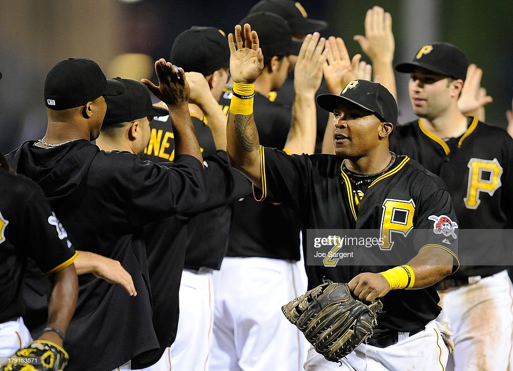 <a gi-track='captionPersonalityLinkClicked' href=/galleries/search?phrase=Marlon+Byrd&family=editorial&specificpeople=217377 ng-click='$event.stopPropagation()'>Marlon Byrd</a> #2 of the Pittsburgh Pirates celebrates with teammates after a 7-1 win over the St. Louis Cardinals on August 31, 2013 at PNC Park in Pittsburgh, Pennsylvania.