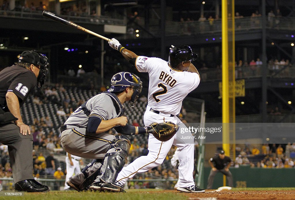 <a gi-track='captionPersonalityLinkClicked' href=/galleries/search?phrase=Marlon+Byrd&family=editorial&specificpeople=217377 ng-click='$event.stopPropagation()'>Marlon Byrd</a> #2 of the Pittsburgh Pirates hits a three run home run in the seventh inning against the Milwaukee Brewers during the game on August 28, 2013 at PNC Park in Pittsburgh, Pennsylvania.