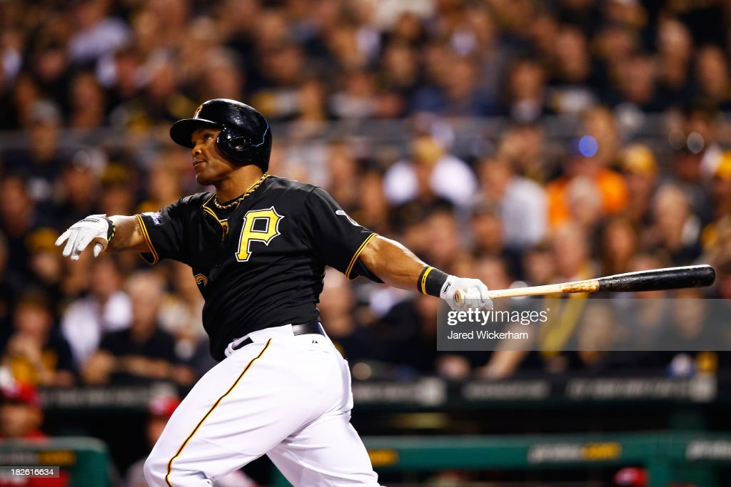 <a gi-track='captionPersonalityLinkClicked' href=/galleries/search?phrase=Marlon+Byrd&family=editorial&specificpeople=217377 ng-click='$event.stopPropagation()'>Marlon Byrd</a> #2 of the Pittsburgh Pirates watches his second inning solo home run against the Cincinnati Reds during the National League Wild Card game at PNC Park on October 1, 2013 in Pittsburgh, Pennsylvania.