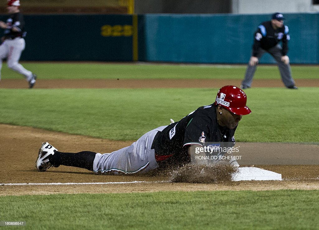 Marlon Byrd of Yaquis de Obregon of Mexico slides safely into third base against Criollos de Caguas of Puerto Rico during the 2013 Caribbean baseball series on February 6, 2013 in Hermosillo in the northern Mexican state of Sonora. The Mexican team won 10-0. AFP PHOTO/Ronaldo Schemidt