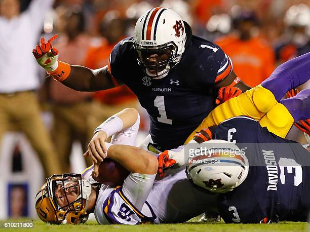 Marlon Davidson and Montravius Adams of the Auburn Tigers sack Danny Etling of the LSU Tigers at JordanHare Stadium on September 24 2016 in Auburn...