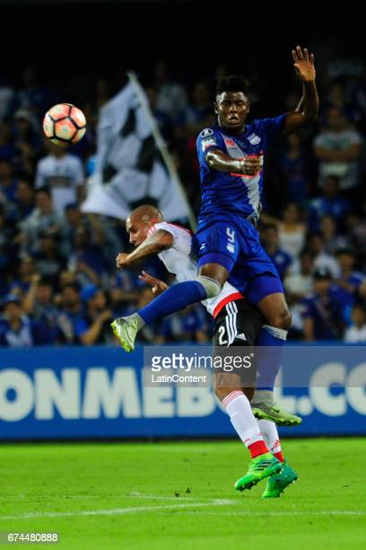 Marlon De Jesus of Emelec and Jonatan Maidana of River Plate jump towards the ball during a group stage match between Emelec and River Plate as part...