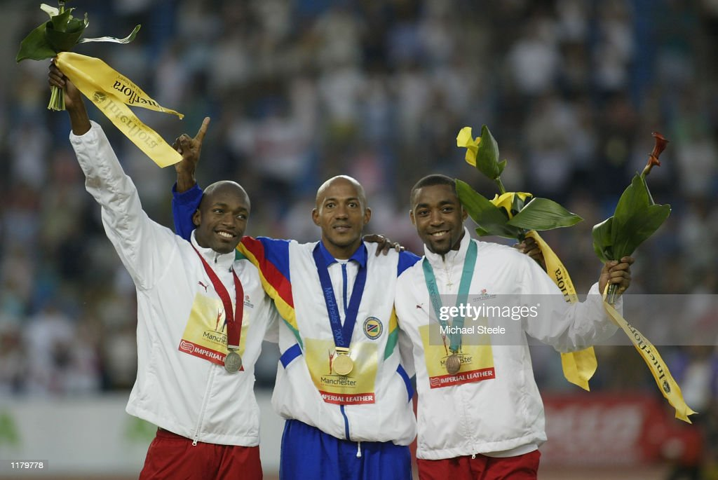 Marlon Devonish of England,Frankie Fredericks of Namibia and Darren Campbell of England during the medal ceremony of the Men's 2oom at the City of Manchester Stadium during the 2002 Commonwealth Games in Manchester, England on July 29, 2002.