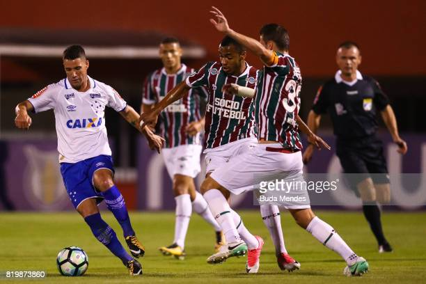 Marlon Freitas and Henrique of Fluminense struggle for the ball with Thiago Neves of Cruzeiro during a match between Fluminense and Cruzeiro as part...