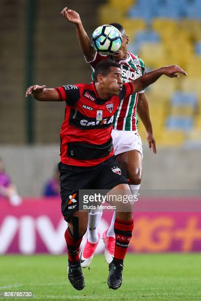 Marlon Freitas of Fluminense struggles for the ball with Walter of Atletico GO during a match between Fluminense and Atletico GO as part of...