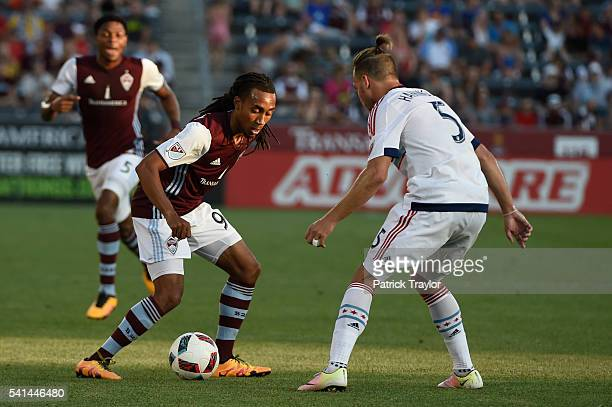 Marlon Hairston of Colorado Rapids battles with Michael Harrington of Chicago Fire during the first half The Colorado Rapids hosted the Chicago Fire...