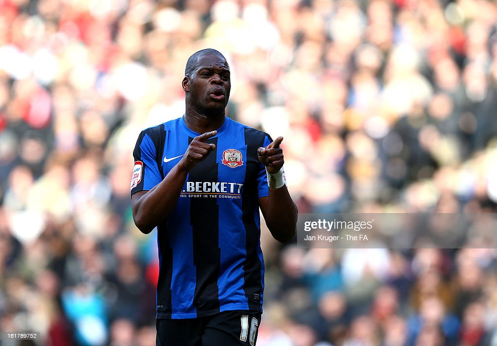 <a gi-track='captionPersonalityLinkClicked' href=/galleries/search?phrase=Marlon+Harewood&family=editorial&specificpeople=206333 ng-click='$event.stopPropagation()'>Marlon Harewood</a> of Barnsley celebrates his goal during the FA Cup with Budweiser Fifth Round match between MK Dons and Barnsley at StadiumMK on February 16, 2013 in Milton Keynes, England.