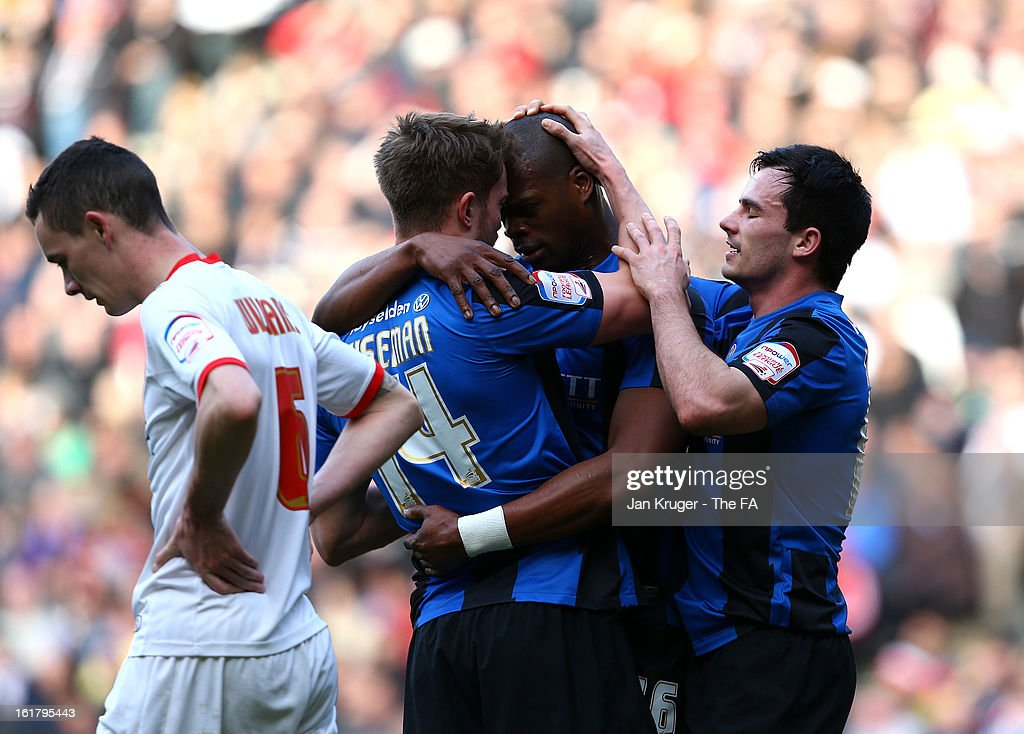 <a gi-track='captionPersonalityLinkClicked' href=/galleries/search?phrase=Marlon+Harewood&family=editorial&specificpeople=206333 ng-click='$event.stopPropagation()'>Marlon Harewood</a> of Barnsley celebrates his goal with team mates Scott Wiseman and Chris Dagnall during the FA Cup with Budweiser Fifth Round match between MK Dons and Barnsley at StadiumMK on February 16, 2013 in Milton Keynes, England.