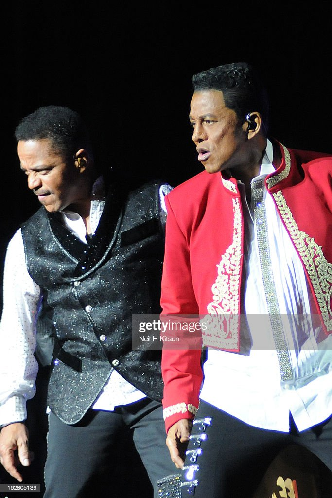 Marlon Jackson (L) and Jackie Jackson of the Jacksons perform on stage in concert at Manchester Apollo on February 27, 2013 in Manchester, England.