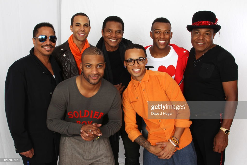 L-R Marlon Jackson, Marvin Humes, JB Gill, Jackie Jackson, Aston Merrygold, OritsT Williams and Tito Jackson pose for a portrait backstage at the 'Michael Forever' concert to remember the late Michael Jackson at The Millenium Stadium on October 8, 2011 in Cardiff, United Kingdom.