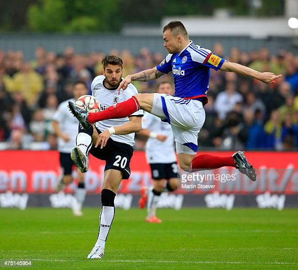 Marlon Krause of Kiel challenges Valdet Rama of Muenchen during the 2 Bundesliga Playoff First Leg between Holstein Kiel and 1860 Muenchen at Holsten...