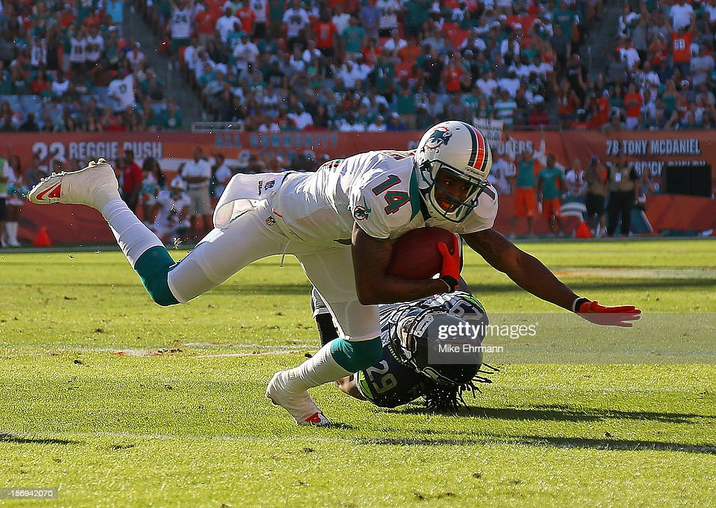 Marlon Moore #14 of the Miami Dolphins makes a catch during a game against the Seattle Seahawks at Sun Life Stadium on November 25, 2012 in Miami Gardens, Florida.