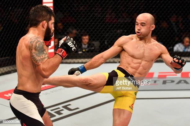 Marlon Moraes kicks Raphael Assuncao of Brazil in their bantamweight bout during the UFC 212 event at Jeunesse Arena on June 3 2017 in Rio de Janeiro...