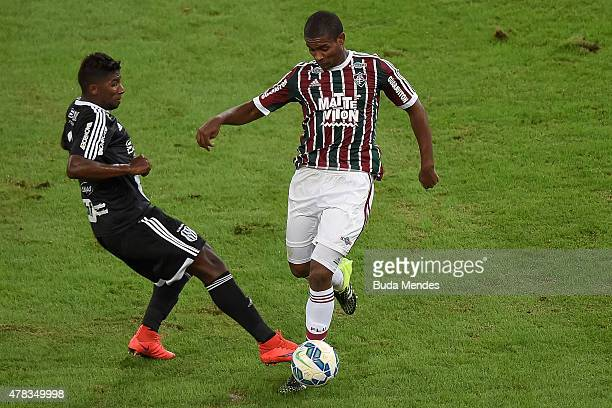 Marlon of Fluminense struggles for the ball with a Rodinei of Ponte Preta during a match between Fluminense and Ponte Preta as part of Brasileirao...
