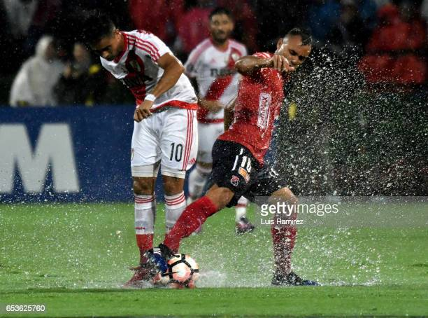 Marlon Piedrahita of Deportivo Independiente Medellin vies for the ball with Gonzalo Martinez of River Plate during a group stage match between...