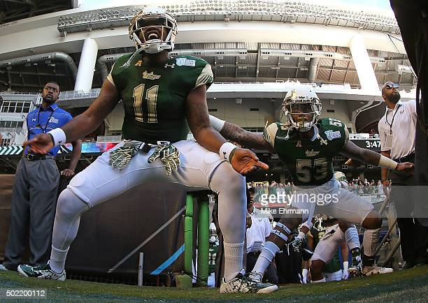 Marlon Pope of the South Florida Bulls takes the field during the 2015 Miami Beach Bowl against the Western Kentucky Hilltoppers at Marlins Park on...