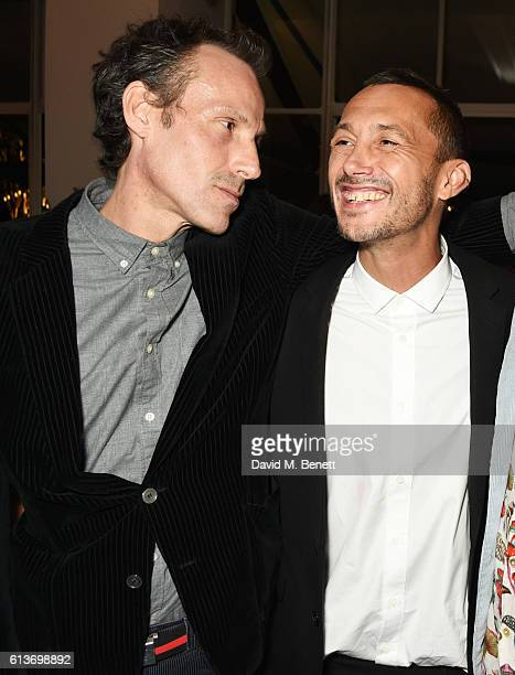 Marlon Richards and Dan Macmillan attend Dan Macmillan Daisy Boyd's engagement party at River Cafe on October 9 2016 in London England