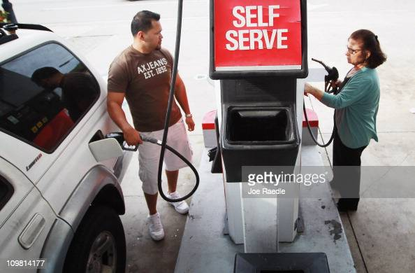 Marlon Roa and Laure pump gas at the Ugas station March 6 2011 in Miami Florida The national average for a gallon of selfserve regular gas was $350 a...