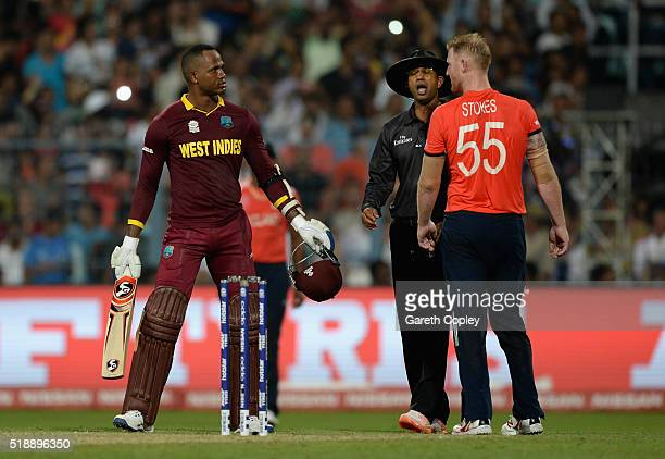 Marlon Samuels of the West Indies and Ben Stokes of England exchange words after Stoke is hit for six runs by Carlos Brathwaite during the ICC World...