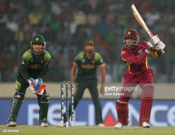 Marlon Samuels of the West Indies bats as Kamran Akmal of Pakistan looks on during the ICC World Twenty20 Bangladesh 2014 match between West Indies...