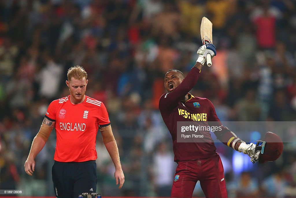 <a gi-track='captionPersonalityLinkClicked' href=/galleries/search?phrase=Marlon+Samuels&family=editorial&specificpeople=185235 ng-click='$event.stopPropagation()'>Marlon Samuels</a> of the West Indies celebrates after Carlos Brathwaite of the West Indies hit the second six of the last over as <a gi-track='captionPersonalityLinkClicked' href=/galleries/search?phrase=Ben+Stokes&family=editorial&specificpeople=6688979 ng-click='$event.stopPropagation()'>Ben Stokes</a> of England looks on during the ICC World Twenty20 India 2016 Final match between England and West Indies at Eden Gardens on April 3, 2016 in Kolkata, India.