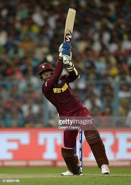 Marlon Samuels of the West Indies hits out for six runs during the ICC World Twenty20 India 2016 Final between England and the West Indies at Eden...