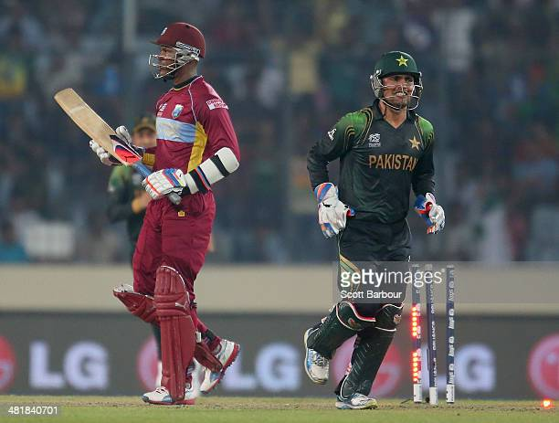 Marlon Samuels of the West Indies leaves the field after being dismissed as Kamran Akmal of Pakistan looks on during the ICC World Twenty20...