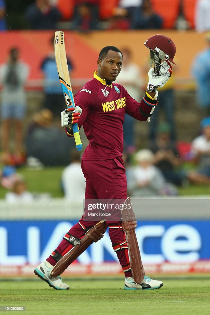 <a gi-track='captionPersonalityLinkClicked' href=/galleries/search?phrase=Marlon+Samuels&family=editorial&specificpeople=185235 ng-click='$event.stopPropagation()'>Marlon Samuels</a> of West Indies celebrates his century during the 2015 ICC Cricket World Cup match between the West Indies and Zimbabwe at Manuka Oval on February 24, 2015 in Canberra, Australia.