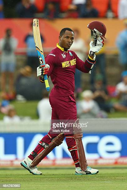 Marlon Samuels of West Indies celebrates his century during the 2015 ICC Cricket World Cup match between the West Indies and Zimbabwe at Manuka Oval...