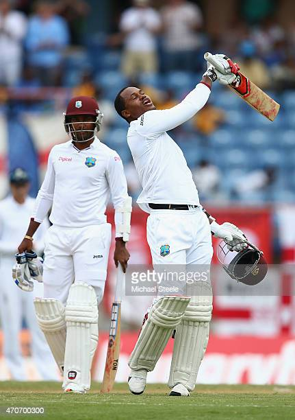 Marlon Samuels of West Indies celebrates reaching his century alongside Denesh Ramdin during day two of the 2nd Test match between West Indies and...
