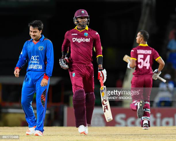 Marlon Samuels of West Indies get runs off Rashid Khan of Afghanistan during the 3rd and final T20i match between West Indies and Afghanistan at...