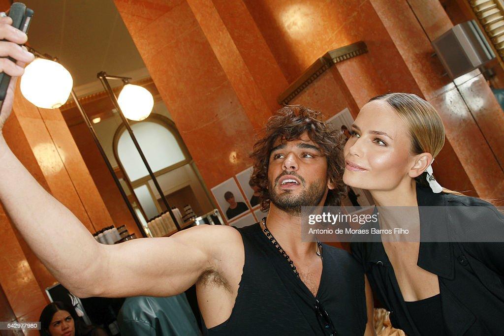 Marlon Teixeira, Natasha Poly taking selfie during backstage before the Balmain Menswear Spring/Summer 2017 show as part of Paris Fashion Week on June 25, 2016 in Paris, France.