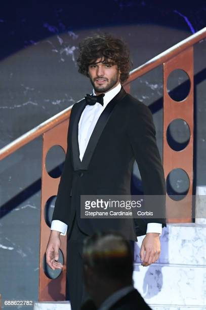 Marlon Teixeira walks the runway during the amfAR Gala Cannes 2017 at Hotel du CapEdenRoc on May 25 2017 in Cap d'Antibes France